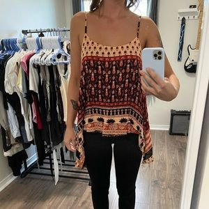 Flowy red, black and peach tank. 100% Rayon.